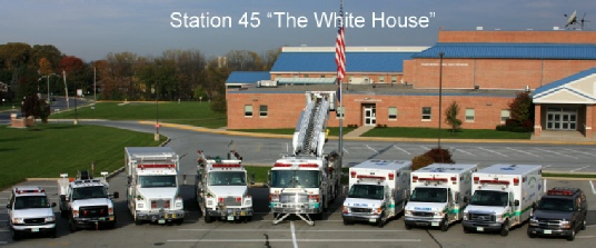 "Fleetwood Volunteer Fire Company Station 45 ""The White House"" with emergency vehicles parked out front."